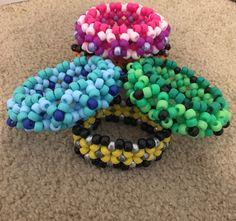 The kandi bundle that includes kandi Cuffs Kandi Patterns, Pearler Bead Patterns, Beading Patterns, Stitch Patterns, Diy Kandi Bracelets, Diy Bracelets Easy, Kandi Mask, Kandi Cuff, Bead Crafts