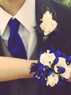 Prom matching, Date wore a blue dress and I wore a charcoal grey suit with a light grey vest and blue tie. Florist took care of Corsage and Boutonnière.