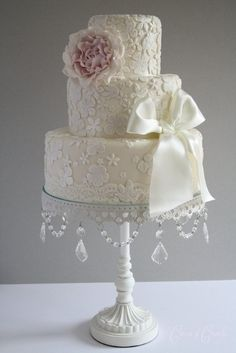 Pretty white lace wedding cake with pale pink peony fondant and ivory satin ribbon bow. Description from pinterest.com. I searched for this on bing.com/images
