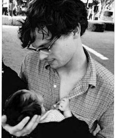 My ovaries can't handle this man holding a baby
