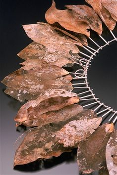"""Arboretum   from Structural Series #1: Decomposition 1999  sterling silver, magnolia leaves, linen  16"""" x 16"""" x .5""""  one-of-a-kind  private collection"""