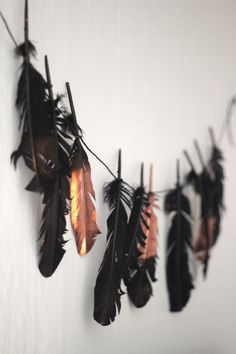 copper spray paint on feathers -