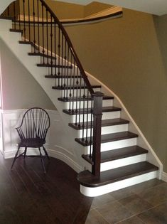 Wrought iron spindles, white risers, dark maple steps. Paint color Sherwin Williams 'chatroom'