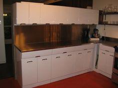 Garth And Martha Have Pro S Soda Blast And Electrostatically Paint Their Vintage Crosley Steel Kitchen Cabinets