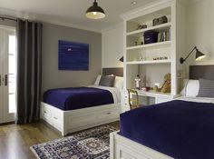 Built-in desk w/ shelving between beds