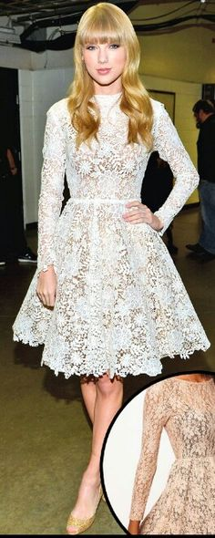 Taylor swift with a white lace bress