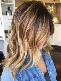 Warm Balayage and Side-Swept Bangs