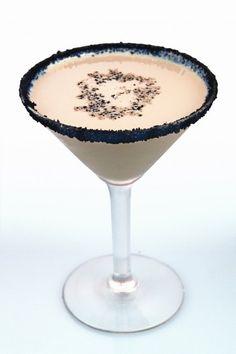 Reindeer Tracks ~ Dutch Chocolate Vodka, Hazelnut Liqueur, Crème de Cacao, a Splash of Cream, and   Chocolate cookie wafers for glass edge