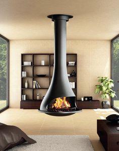 Une #cheminée centrale : http://www.m-habitat.fr/cheminees/styles-de-cheminees/cheminee-centrale-178_A