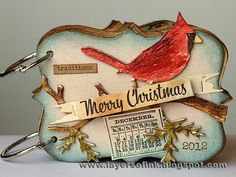 Mini-Book with tutorial by Anna-Karin Evaldsson (12512)  [(dies) Sizzix Bigz Christmas Cardinal; Mover & Shapers Cargo Stencil Numbers, Ornamental, Pocket Envelope; Sizzlits Tattered Banners;  (stamps)  Hero Arts  Greatest Gift, Holiday Cheer, Holiday Sayings, Let It Snow, Sending Holiday Cheer, Spirit of the Season; Stampers Anonymous Tim Holtz Christmas Time, Classics #9, Flourish, Grunge Snowflakes, Ledger, Mini Blueprints, Mini Holidays, Mini Holidays 2, Mini Holidays 4]