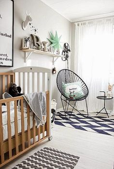 I prefer a white cot but apart from that lovely accessories. not babyish the chair and table is cool. graphic rug