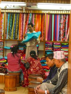 Sari Salesman, Kathmandu, Nepal - Explore the World with Travel Nerd Nici, one Country at a Time. http://travelnerdnici.com