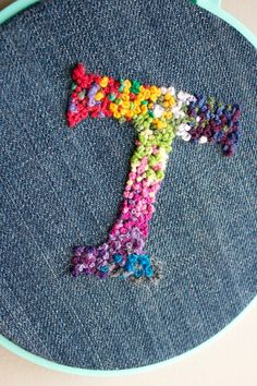 Items similar to Custom Hand Embroidered Letter // Custom Embroidery // Colorful French Knots // Wall Decoration // Embroidered Initial // Denim Hoop Art on Etsy Use knots to fill in instead of satin stitch. For Boys: Taft, Tron, Tyndall LOVE the bright Embroidery Alphabet, Embroidery Hoop Art, Cross Stitch Embroidery, Embroidery Designs, Flower Embroidery, Embroidered Flowers, French Knot Embroidery, Modern Embroidery, Custom Embroidery