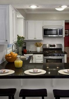 A very compact kitchenu-shaped-kitchen gets an increase in style from the beautiful black countertops. -18