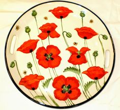 Poppy ceramic tray, a current pattern painted by Geoff Graham in Vallejo, California at Cinnabar Ceramics.  You can google the Cinnabar Ceramics Website if you want to know more.