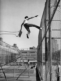 This photo fascinates me. Remember when we used to fly as high as we could on a swing and jump? Don't think I ever flew this high.Was he able to grab the fence? Did he miss and fall and get badly injured? Parkour, Photos Black And White, Black And White Photography, Black White, Poses, Inge Morath, Chance Chanel, Foto Art, Photomontage