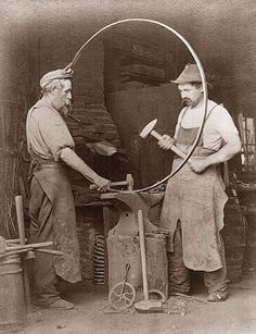 Back before the days of cars, Wheelwrights were the tradesmen that built and repaired wagon wheels. It required both woodworking skill, as well as skills similar to a blacksmith. In fact, some blacksmiths were also wheelwrights. The picture above was taken in 1903. Probably not many wheelwrights left outside the amish communities.