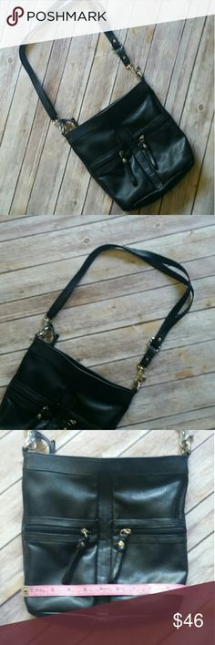 PIELINO crossbody Italian made black leather crossbow purse with adjustable strap. Zipper closure. Two front pockets and one rear. Silver toned hardware. Great condition Pielino Bags Crossbody Bags