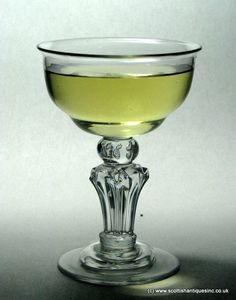 Georgian Pedestal Stem Champagne Glass c1740   An excellent example that needs to be used, and to give you a better idea as to how it looks when put to its intended use one photograph shows the glass brimming with bubbly. Champagne not included.  http://scottishantiques.com/georgian-wine-glasses/pedestal-stem/champagne-coupe2#.VgsQ9M5Cm-4