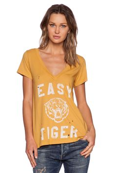 """Just bought this shirt on pre-order from Revolve.  """"Easy Tiger Tee"""" by Rebel Yell Love the dandelion yellow color of it! #REVOLVEclothing"""