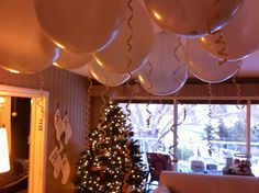 New Years Eve decor.  Balloons hung upside down with marbles inside. Maybe just gold balloons on some tables