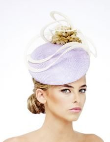Rosie Olivia Millinery Tokyo Straw Beret in lilac trimmed with an ivory net sculpture and champagne colored feathered flowers.