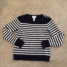 Talbots black and white striped cashmere sweater It's cashmere and size Petite Medium. Three silver buttons on one shoulder. It is in good used condition, no major flaws that I can detect. Very soft and cozy! Talbots Sweaters Crew & Scoop Necks