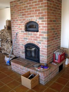 "Masonry stove, this one is not as ""fancy"" as others I have seen but has style! love that is is red brick"