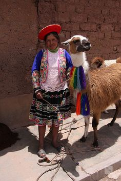 Woman in traditional clothes with llama, Cusco, Peru