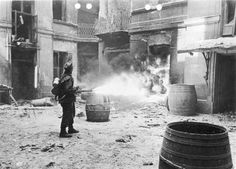 German soldier setting fire to a building in Warsaw, September 1944. Via Wikimedia Commons.