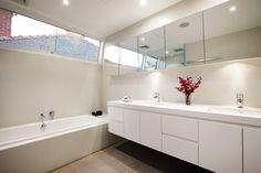 nice bright light filled bathroom, high windows, angled
