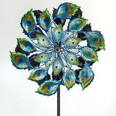 Buy Bits and Pieces - Solar Peacock Wind Spinner - Decorative Solar Powered Kinetic Wind Mill: Glass Ball Emits Color-Changing... by V-Toy&Game