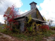 """Lessons Learned"" -- An old, abandoned school-house succumbs to nature is surrounded by the colors of autumn. Photo taken in southeastern Ohio USA near Blue Rock, Muskingum County, Ohio. Photograph by Trendle Ellwood - January 17 2012 Abandoned Ohio, Old Abandoned Buildings, Old Buildings, Abandoned Places, Abandoned Castles, Old Country Churches, Old Churches, School's Out Forever, Old School House"