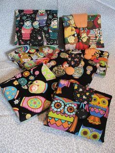 Carteira em tecido importado,100%algodão, diversas estampas, com porta cheques, porta moedas e diversas repartições R$40,00