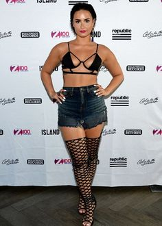8838781b84d4a Demi Lovato Rocks Bondage-Inspired Bikini and Caged Boots for Pool Party
