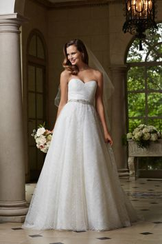 Ballgown elegance from Watters: http://www.stylemepretty.com/2015/03/26/designer-spotlight-from-the-smp-look-book-a-giveaway-discounts/