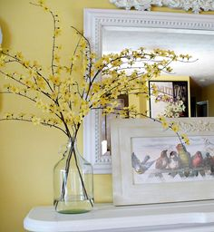 Upcycled glass jar with spring branches