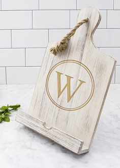 Give your favorite chef the perfect gift this year with a personalized wood cookbook stand!