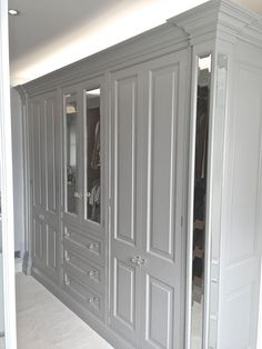 Sterlingdale's bespoke dressing room with built in wardrobes and mirrored columns, with open framed cabinets to expose the oak inside. The doors are either raise and field panel doors or bevelled edge mirrored doors