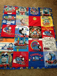 A small Thomas quilt made from outgrown tshirts.