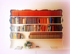 My grandparents had a book shelf like this. It was difficult to remove the books. But it's gorgeous.