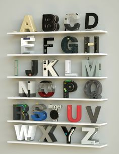 """Taking inspiration from a wide variety of electronic brands, designer Vinicius Araújo designed this alphabet of Helvetica letterforms, each modeled after a brand's namesake product. The letter """"N"""" for Nintendo becomes a retro-styled NES gaming system while the """"B"""" for Beats grabs the aesthetic of co"""