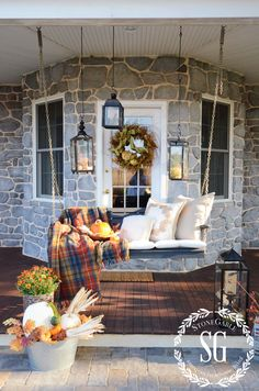 Love this back porch and that swing - so pretty for fall
