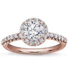 Rose gold engagement ring with a halo, this girl wants nothing more than this!!!