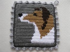 Collie Dog Pot Holders. Gray crochet potholders with door hooknsaw
