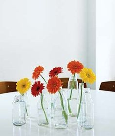 Repeat Milk Bottles as Vases | How to refresh a room using boxes, jars, and other household items.