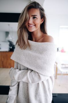 Off the shoulder white knit sweater.