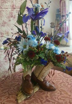 Use hubby's old combat boots, put vase in each, add red, white and blue flowers and a small American flag