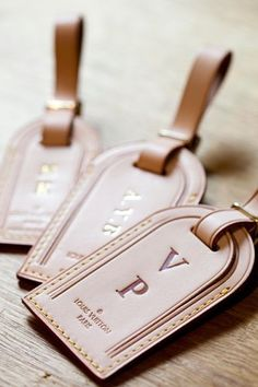 Louis Vuitton luggage tag. Customize with initials or a special note to make it an extra special gift.