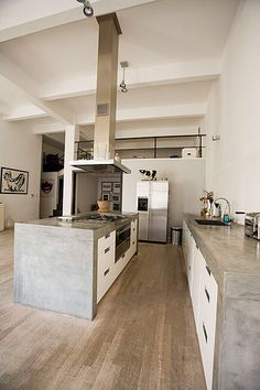 If you are looking to revamp your kitchen or building one from scratch, a concrete countertop is the coolest choice in It looks chic, minimal and earthy and goes with all types of interiors. Kitchen design home interiors countertops minimal decor ideas Kitchen Inspirations, Interior Design Kitchen, Concrete Kitchen, Kitchen Space, Home, Loft Kitchen, Trendy Kitchen, Modern Kitchen Design, Loft Apartment